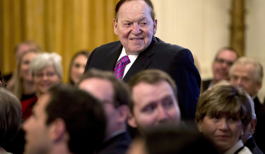 FILE - In this Nov. 16, 2018, file photo, Las Vegas Sands Corporation Chief Executive and Republican mega donor Sheldon Adelson, stands as he is recognized by President Donald Trump during a Medal of Freedom ceremony in the East Room of the White House in Washington. Casino magnate and GOP donor Adelson is not in good health and has not being at his company's offices in Las Vegas since around Christmas Day. Las Vegas Sands Corp. on Thursday, Feb. 28, 2019, did not immediately respond to a request for comment. Attorney James Jimmerson told the court the condition of the 85-year-old billionaire is dire. (AP Photo/Andrew Harnik, File)