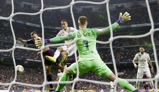 Barcelona goalkeeper Marc-Andre ter Stegen makes a save during the Copa del Rey semifinal second leg soccer match between Real Madrid and FC Barcelona at the Bernabeu stadium in Madrid, Wednesday, Feb. 27, 2019. Barcelona won 3-0. (AP Photo/Manu Fernandez)
