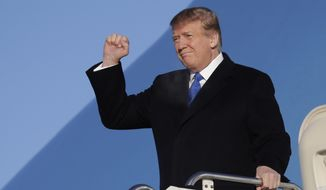 President Donald Trump arrives at Joint Base Elmendorf-Richardson, Thursday, Feb. 28, 2019, in Anchorage, Alaska., during a refueling stop as he returns from Hanoi. (AP Photo/ Evan Vucci) ** FILE **