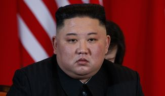 North Korean leader Kim Jong-un listens to President Donald Trump speak during a meeting, Thursday, Feb. 28, 2019, in Hanoi. (AP Photo/ Evan Vucci) ** FILE **