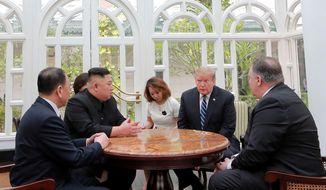 ALTERNATE CROP OF KNS802 - In this Thursday, Feb. 28, 2019, photo provided Friday, March 1, 2019, by the North Korean government, U.S. President Donald Trump, second from right, and North Korean leader Kim Jong Un, second from left, talk at a hotel in Hanoi, Vietnam. U.S. Sec. of State Mike Pompeo is at right. Kim Yong Chol, a North Korean senior ruling party official and former intelligence chief is at left. The content of this image is as provided and cannot be independently verified. (Korean Central News Agency/Korea News Service via AP)