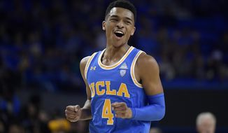UCLA guard Jaylen Hands reacts after hitting a 3-point shot during the first half of an NCAA college basketball game against Southern California Thursday, Feb. 28, 2019, in Los Angeles. (AP Photo/Mark J. Terrill)