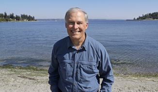 In this photo taken July 23, 2018, Washington Gov. Jay Inslee poses for a photo on the beach near his home on Bainbridge Island, Wash. Inslee is adding his name to the growing 2020 Democratic presidential field. The 68-year-old is announcing his bid Friday, March 1, 2019, in Seattle after recent travels to two of the four early-nominating states. (AP Photo/Ted S. Warren)