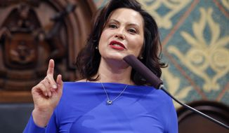 FILE - In this Feb. 12, 2019 file photo, Michigan Gov. Gretchen Whitmer delivers her State of the State address to a joint session of the House and Senate at the state Capitol in Lansing, Mich. Whitmer is abolishing Michigan's medical marijuana licensing board and folding its functions into a newly created regulatory agency. The Democrat issued an executive order Friday, March 1, 2019, to create the Marijuana Regulatory Agency. The board has been criticized as too slow to issue licenses following a law that instituted a tiered regulatory system. (AP Photo/Al Goldis, File)