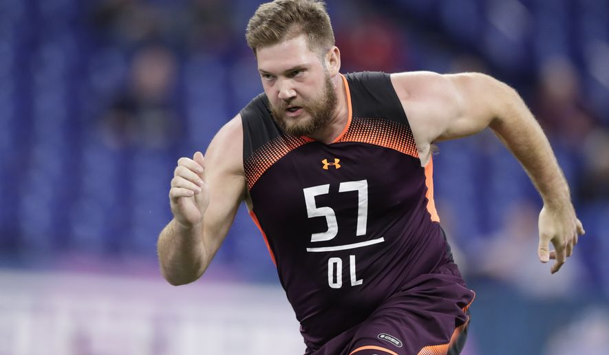 Alabama offensive lineman Jonah Williams runs a drill at the NFL football scouting combine in Indianapolis, Friday, March 1, 2019. (AP Photo/Michael Conroy)