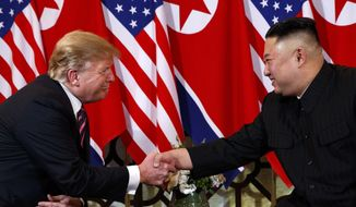 In this Wednesday, Feb. 27, 2019, file photo, U.S. President Donald Trump shakes hands with North Korean leader Kim Jong Un in Hanoi. Trump said he walked away from his second summit with North Korean leader Kim Jong Un because Kim demanded the U.S. lift all of its sanctions, a claim that North Korea's delegation called a rare news conference in the middle of the night to deny. (AP Photo/ Evan Vucci, File)