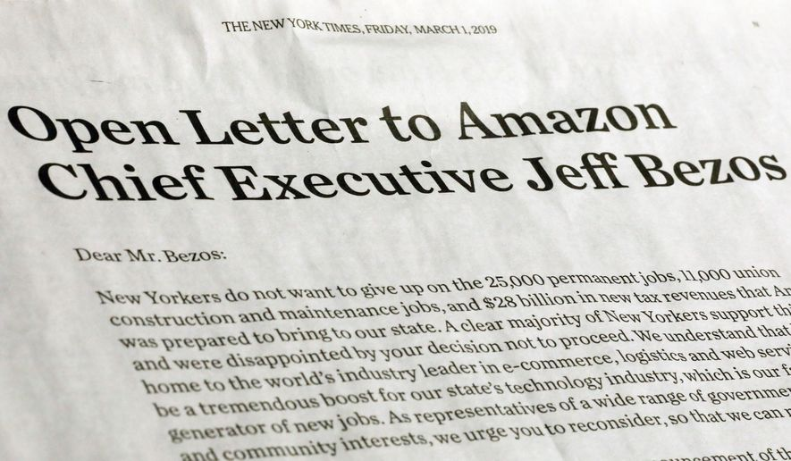 This photo shows a portion of an open letter published in the Friday, March 1, 2019 edition of The New York Times, signed by a group of business leaders, elected officials and others, urging Amazon CEO Jeff Bezos to reconsider the decision to abandon building a headquarters in New York City. The deal would have had Seattle-based Amazon redevelop a site in the Long Island City section of the Queens borough of New York, for one of two new headquarters. The company expected to base 25,000 jobs there. (AP Photo/Richard Drew)