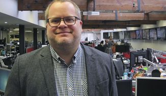 Associated Press journalist Matt Chandler poses for a photo in the newsroom of AP's London bureau, Friday, March 1, 2019. The international news cooperative announced Friday that Chandler, a senior news leader who has produced award-winning coverage of drug trafficking and cartel violence in Mexico and investigations into Central American gangs, has been named News Director for Latin America and the Caribbean. (AP Photo)