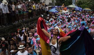 A reveler performs during the Carmelitas street party in Rio de Janeiro, Brazil, Friday, March 1, 2019. Much of the appeal of Rio street parties is the variety of themes and that people can dress up in costumes or not. (AP Photo/Leo Correa)