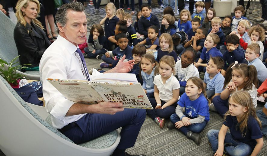 "Gov. Gavin Newsom reads the book ""Rosie Revere, Engineer by Andrea Beaty and David Roberts to kindergarteners at the Washington Elementary School in Sacramento, Calif., Friday, March 1, 2019. Newsom, accompanied by his wife, Jennifer Siebel Newsom, left, visited the school to celebrate Read Across America Day. (AP Photo/Rich Pedroncelli)"