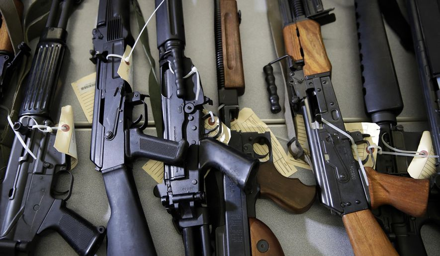 FILE - In this Oct. 9, 2018, file photo, Illegally possessed firearms seized by authorities are displayed at a news conference in Los Angeles. Attorney General Xavier Becerra is set to unveil new 2018 numbers from a uniquely California program that seizes guns from people no longer allowed to own them. He's expected to acknowledge Friday, March 1, 2019, that a backlog of illegally held weapons remains despite an infusion of millions of dollars to beef up enforcement efforts in recent years. (AP Photo/Jae C. Hong, File)