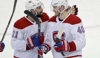Montreal Canadiens right wing Joel Armia (40) celebrates with center Nate Thompson (21) after the Canadiens beat the New York Rangers 4-2 in an NHL hockey game, Friday, March 1, 2019, in New York. Armia scored three goals in the game. (AP Photo/Julie Jacobson)