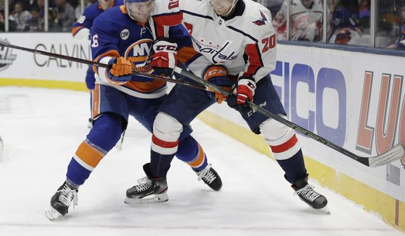 New York Islanders' Ryan Pulock (6) fights for control of the puck with Washington Capitals' Lars Eller (20) during the first period of an NHL hockey game Friday, March 1, 2019, in Uniondale, N.Y. (AP Photo/Frank Franklin II) ** FILE **