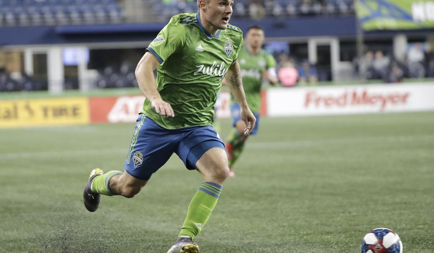 Seattle Sounders forward Jordan Morris drives against Club Nacional during the second half of an exhibition soccer match Wednesday, Feb. 20, 2019, in Seattle. Club Nacional won 2-0. (AP Photo/Ted S. Warren)