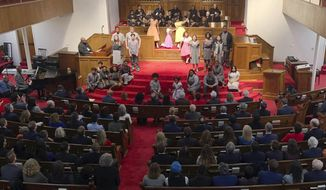 Members of Congress and others watch a play depicting the lives of four girls killed in a 1963 bombing at 16th Street Baptist Church in Birmingham, Ala., on Friday, March 1, 2019. Dozens of members of Congress are participating in a weekend-long pilgrimage civil rights pilgrimage through the state. (AP Photo/Jay Reeves)