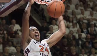 Virginia Tech forward Kerry Blackshear Jr. dunks against Duke during the second half of an NCAA college basketball game in Blacksburg, Va., Tuesday, Feb. 26, 2019. (AP Photo/Lee Luther Jr.) **FILE**