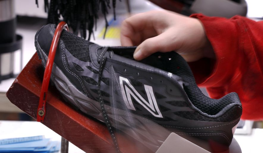 FILE- In this Dec. 17, 2018, file photo, a pair of athletic shoes designed for the military are laced up at a New Balance factory in Norridgewock, Maine. On Friday, March 1, 2019, the Institute for Supply Management, a trade group of purchasing managers, issues its index of manufacturing activity for February. (AP Photo/Robert F. Bukaty, File)