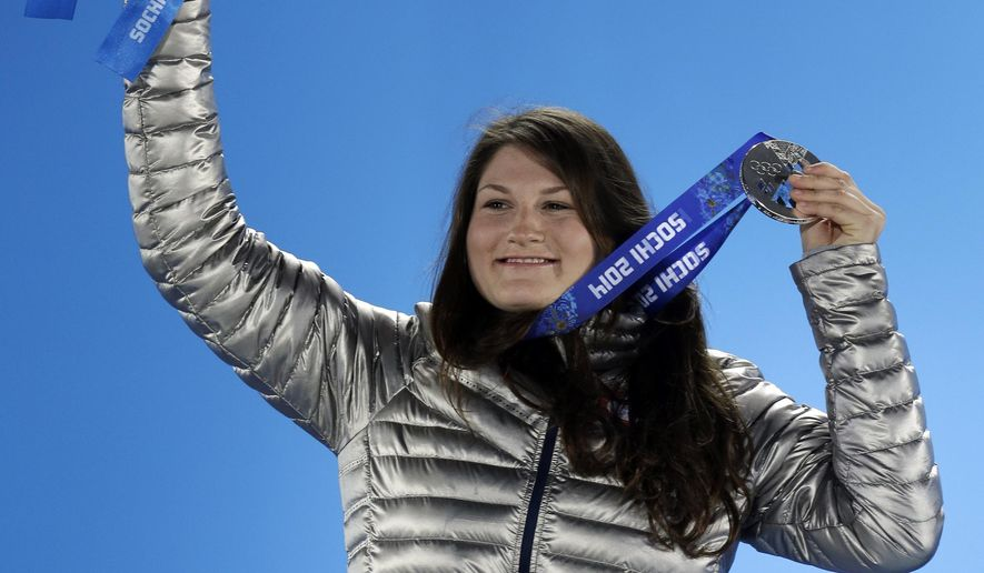 FILE - In this Tuesday, Feb. 11, 2014 file photo, women's freestyle skiing slopestyle silver medalist Devin Logan of the United States holds her medal during the medals ceremony at the 2014 Winter Olympics in Sochi, Russia. Olympic silver medalist Devin Logan is serving a three-month suspension for using a cannabis-based product that contained higher-than-allowed levels of the banned substance, THC. Logan, who won the silver medal in slopestyle at the Sochi Games in 2014, will come off suspension on March 6, 2019. She tested positive at an event in December. She used a Cannabidiol (CBD) product, the likes of which are increasingly being used to treat pain .(AP Photo/Morry Gash, File)
