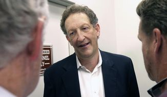 """FILE - In this Monday, Oct. 5, 2015 file photo, San Francisco Giants president and CEO Larry Baer speaks to reporters after a news conference in San Francisco. A video posted by TMZ on Friday, March 1, 2019 shows Giants President and CEO Larry Baer in a physical altercation with his wife in a San Francisco park. Baer's wife, Pam, was seated in a chair when he reached over her to grab for a cellphone in her right hand and she toppled sideways in the chair screaming """"Oh my God!"""" and kicking a leg. Witnesses saw the ordeal in the public plaza. (AP Photo/Jeff Chiu, File)"""