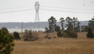 Dominion Energy Virginia's new Skiffes Creek transmission line is seen from Hog Island Wildlife Management Area Wednesday, Feb. 27, 2019.  (Jonathon Gruenke/The Daily Press via AP)
