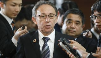 Okinawa Governor Denny Tamaki talks to reporters following meeting with Japanese Prime Minister Shinzo Abe to report result of a local referendum at the prime minister's official residence in Tokyo, Japan, Friday, March 1, 2019. The residents of Japan's southwestern island region of Okinawa rejected a relocation plan for a U.S. military base in the Feb. 24 referendum, increasing pressure on the national government to change its stance that the facility will be built no matter what. (Kimimasa Mayama/Pool Photo via AP)