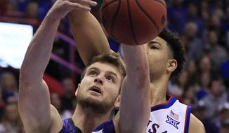 Kansas State forward Dean Wade (32) rebounds in front of Kansas guard Quentin Grimes, back, during the second half of an NCAA college basketball game in Lawrence, Kan., Monday, Feb. 25, 2019. (AP Photo/Orlin Wagner)
