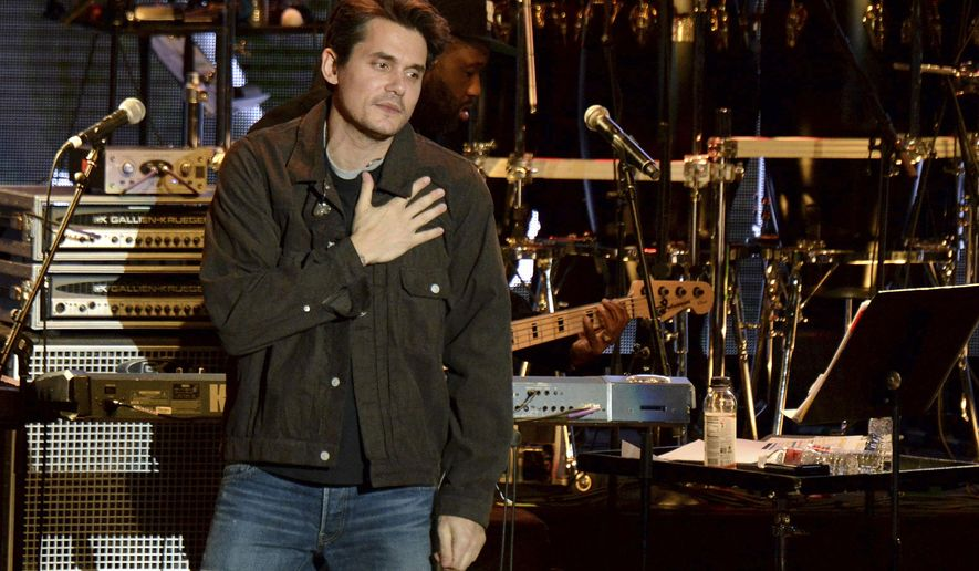 FILE - In this Oct. 31, 2018 file photo, John Mayer gestures to the crowd during the tribute event Mac Miller: A Celebration of Life at the Greek Theatre in Los Angeles.  Mayer is launching a foundation focused on improving the health of veterans through scientific research. The singer on Friday, March 1, 2019 announced The Heart and Armor Foundation, which plans to focus on veterans with post-traumatic stress and meeting the emerging needs of women veterans. (Photo by Amy Harris/Invision/AP, File)