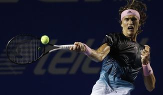 Germany's Alexander Zverev returns a ball in his Mexican Tennis Open semifinal match against Great Britain's Cameron Norrie, in Acapulco, Mexico, Friday, March 1, 2019. (AP Photo/Rebecca Blackwell)