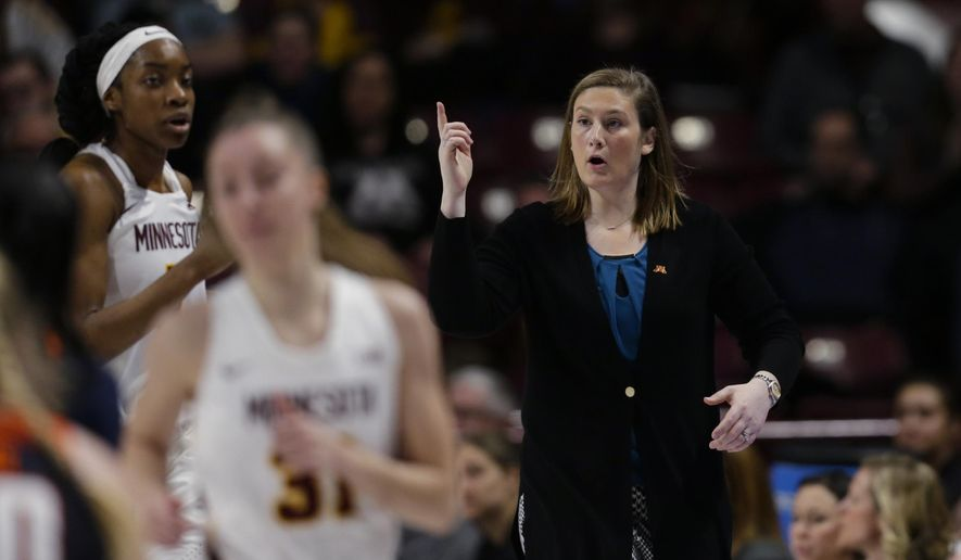 FILE - In this Jan. 6, 2019, file photo, Minnesota coach Lindsay Whalen gestures during the team's NCAA college basketball game against Illinois in Minneapolis. Whalen's team got off to a perfect start, winning all 11 non-conference games and earning a Top 25 ranking. Then Big Ten play set in and the Golden Gophers struggled, losing seven of their first nine games in the conference. Losing games helped give Whalen a better perspective of what it took to be a good coach. (AP Photo/Andy Clayton-King, File)