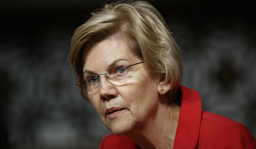 """This Feb. 29, 2019, file photo shows Senate Armed Services Committee member, Sen. Elizabeth Warren, D-Mass., during a Senate Armed Services Committee hearing on """"Nuclear Policy and Posture"""" on Capitol Hill in Washington. (AP Photo/Carolyn Kaster, File)"""