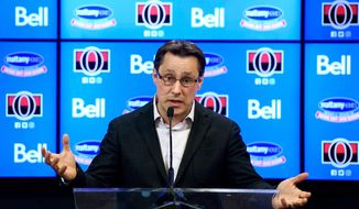 FILE - In this April 9, 2018, file photo, Ottawa Senators head coach Guy Boucher speaks during an end of season NHL hockey press conference in Ottawa. The Senators have fired coach Guy Boucher and named Marc Crawford as the interim replacement. General manager Pierre Dorion announced the abrupt firing Friday, March 1, 2019. (Justin Tang/The Canadian Press via AP, File)
