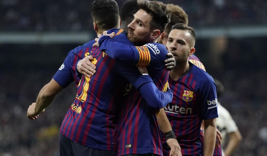 Barcelona forward Lionel Messi, center, celebrates with Barcelona forward Luis Suarez celebrates after Real defender Raphael Varane scores an own goal during the Copa del Rey semifinal second leg soccer match between Real Madrid and FC Barcelona at the Bernabeu stadium in Madrid, Spain, Wednesday Feb. 27, 2019. (AP Photo/Andrea Comas)