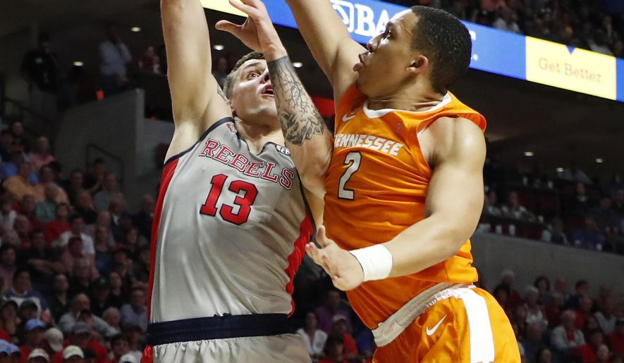 Tennessee forward Grant Williams (2) blocks a shot attempt by Mississippi center Dominik Olejniczak (13) during the second half of an NCAA college basketball game in Oxford, Miss., Wednesday, Feb. 27, 2019. Tennessee won 73-71. (AP Photo/Rogelio V. Solis)