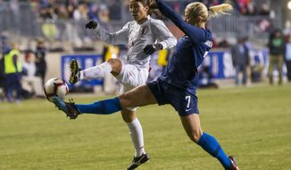 Japan's Emi Nakajima, left, and United States' Abby Dahlkemper, right, reach for the ball during the second half of SheBelieves Cup soccer match, Wednesday, Feb. 27, 2019, in Chester, Pa. The match ended in a 2-2 tie. (AP Photo/Chris Szagola)