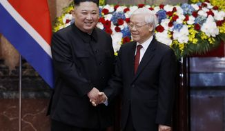 North Korea's leader Kim Jong Un and Vietnam's President Nguyen Phu Trong, right, shake hands at the President Palace, Friday, March 1, 2019, in Hanoi, Vietnam. Kim Jong-un is on a two-day official visit to Vietnam that will conclude on March 2. (AP Photo Minh Hoang, Pool)