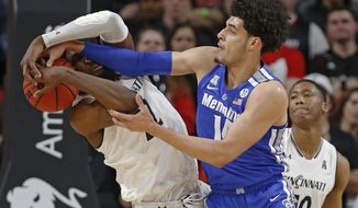 Memphis forward Isaiah Maurice, right, battles Cincinnati forward Eliel Nsoseme (22) for a rebound during the first half of an NCAA college basketball game Saturday, March 2, 2019, in Cincinnati. (AP Photo/Gary Landers)