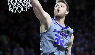 Kansas State forward Dean Wade (32) dunks during the second half of an NCAA college basketball game against Baylor in Manhattan, Kan., Saturday, March 2, 2019. (AP Photo/Orlin Wagner)