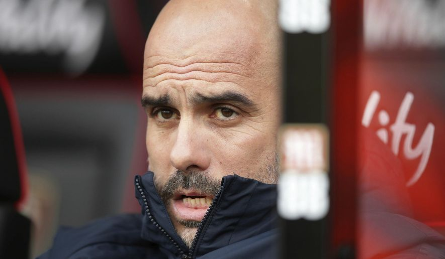 Manchester City manager Pep Guardiola gestures, prior to the start of the English Premier League soccer match between Bournemouth and Manchester City,  at the Vitality Stadium, in  Bournemouth, England, Saturday March 2, 2019. (Adam Davy/PA via AP)
