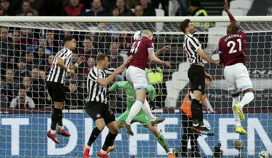 West Ham United's Declan Rice, centre , cores his side's first goal of the game during the English Premier League soccer match between West Ham and Newcastle United at London Stadium, in London, Saturday March 2, 2019. (Paul Harding/PA via AP)