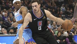 Los Angeles Clippers forward Danilo Gallinari, right, drives against Sacramento Kings guard De'Aaron Fox during the first quarter of an NBA basketball game in Sacramento, Calif., Friday, March 1, 2019. (AP Photo/Rich Pedroncelli)