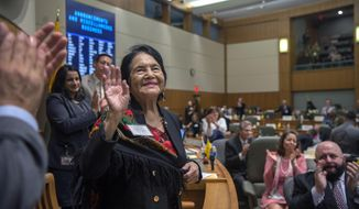 Labor and civil rights leader Dolores Huerta is honored on the floor of the House of Representatives, Wednesday, Feb. 27, 2019, in Santa Fe, N.M. Huerta is co-founder of the National Farmworkers Association. (Eddie Moore/The Albuquerque Journal via AP)