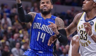 Orlando Magic guard D.J. Augustin (14) drives in to score during the first half of an NBA basketball game against the Indiana Pacers, Saturday, March 2, 2019, in Indianapolis. (AP Photo/Doug McSchooler)