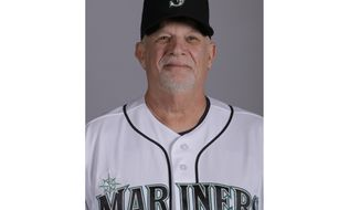 This is a 2019 photo of Perry Hill of the Seattle Mariners baseball team. This image reflects the Seattle Mariners active roster as of Monday, Feb. 18, 2019, when this image was taken. Ask around the Seattle Mariners complex and the most popular person putting on a uniform each day is likely a 66-year-old who is nearly four decades removed from playing professionally, and has become a respected authority throughout baseball as one of the best infield instructors around. The move by the Mariners to hire Hill as their first-base and infield coach in the offseason went mostly unnoticed, but his influence is already being noticed.(AP Photo/Charlie Riedel)