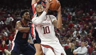 Arkansas forward Daniel Gafford (10) tries to get past Mississippi defender Dominik Olejniczak (13) during the first half of an NCAA college basketball game, Saturday, March 2, 2019 in Fayetteville, Ark. (AP Photo/Michael Woods)