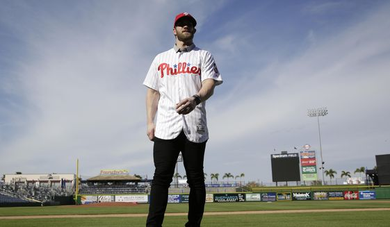 Bryce Harper walks on the field after being introduced as a Philadelphia Phillies player during a news conference at the team's spring training baseball facility, Saturday, March 2, 2019, in Clearwater, Fla. Harper and the Phillies agreed to a $330 million, 13-year contract, the largest deal in baseball history. (AP Photo/Lynne Sladky) **FILE**