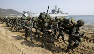 In this March 30, 2015, photo, South Korean Marines march after landing on the beach during the U.S.-South Korea joint landing military exercises as a part of the annual joint military exercise Foal Eagle between South Korea and the United States in Pohang, South Korea. (AP Photo/Lee Jin-man) **FILE**
