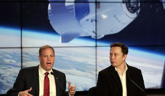 NASA Administrator Jim Bridenstine, left, and Elon Musk, CEO of SpaceX, answer questions during a news conference after the SpaceX Falcon 9 Demo-1 launch at the Kennedy Space Center in Cape Canaveral, Fla., Saturday, March 2, 2019.  (AP Photo/John Raoux)