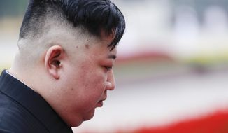 North Korean leader Kim Jong Un attends a wreath laying ceremony at Ho Chi Minh Mausoleum in Hanoi, Vietnam, Saturday, March 2, 2019. Kim has paid his respects to Vietnamese revolutionary leader Ho Chi Minh, whose embalmed body is on permanent display, just like Kim's own father and grandfather in North Korea. (Jorge Silva/Pool Photo via AP)
