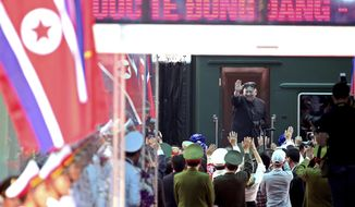 North Korean leader Kim Jong-un waves at Dong Dang railway station in Dong Dang, Vietnam, Saturday, March 2, 2019.  Kim has boarded his private train at the Vietnam-China border, ending a trip that saw a summit breakdown with U.S. President Donald Trump. (AP Photo/Minh Hoang) ** FILE **