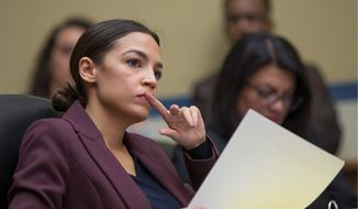 """""""He's not on my payroll. They were not working for me and they were two separate entities here,"""" Rep. Alexandria Ocasio-Cortez said. (Associated Press)"""
